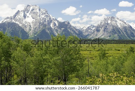 Beautiful snow capped mountains in the Grand Tetons. - stock photo