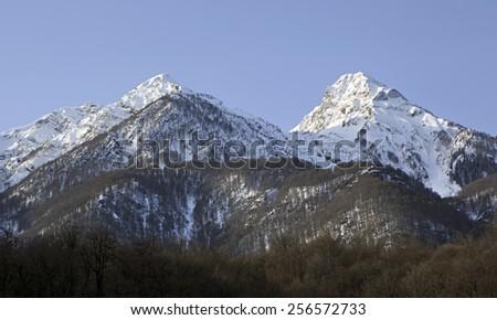 Beautiful snow-capped peaks of the Caucasus Mountains. Rosa Khutor Alpine Resort in Sochi. Russia. - stock photo