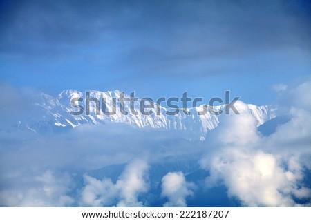 Beautiful snow-covered Machhapuchhre and Annapurna range from Sarangkot peak - stock photo