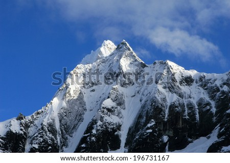 Beautiful snow covered mountain peaks in the Cordillera Blanca range of Huascaran National Park, Peru - stock photo