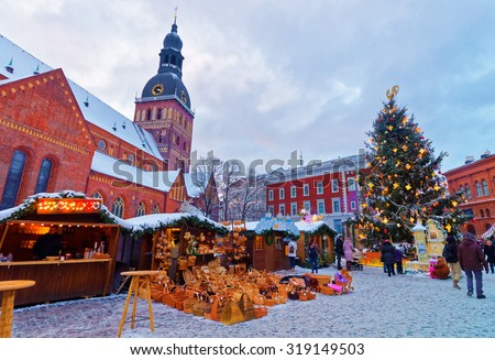 Beautiful snowy winter scenery of Christmas holiday fair at Dome Square in Riga's Old Town, Latvia - stock photo