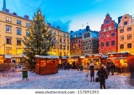 Beautiful snowy winter scenery of Christmas holiday fair at the Big Square (Stortorget) in the Old Town (Gamla Stan) in Stockholm, Sweden - stock photo