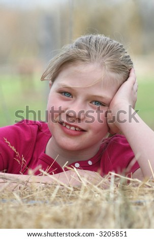 Beautiful soft focused portrait of country girl. - stock photo
