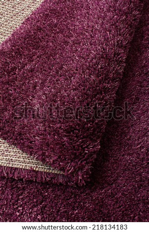 Beautiful soft shaggy carpet of violet color - stock photo