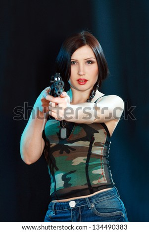 beautiful soldier woman with rifle military uniform over black background - stock photo