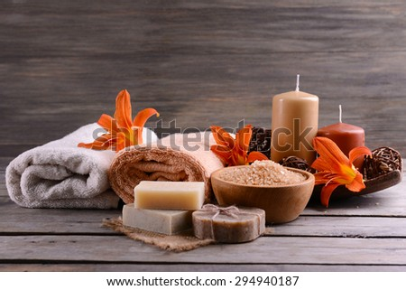 Beautiful spa composition with flowers on wooden table close up - stock photo