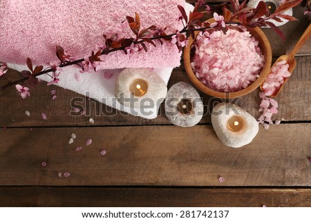 Beautiful spa composition with spring flowers on table close up - stock photo
