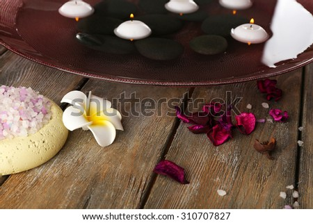 Beautiful spa composition with stones on table close up - stock photo