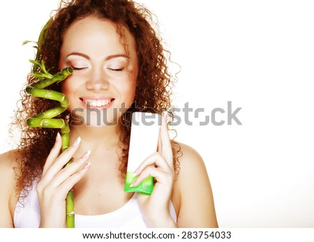 Beautiful spa girl holding jar of cream and bamboo  isolated on white background - stock photo