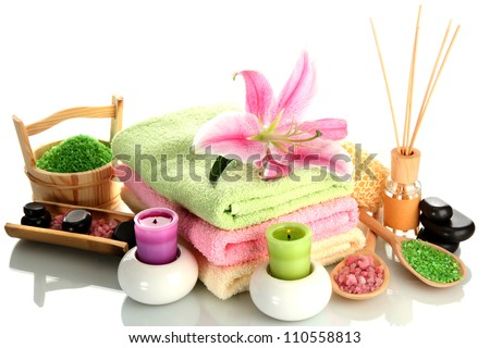 beautiful spa setting with lily isolated on white - stock photo