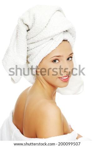Beautiful spa woman in bathrobe and turban. - stock photo