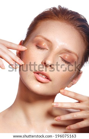 Beautiful Spa Woman Touching her chin. Youth and Skin Care Concept. Beautiful girl after a shower with wet hair and clean skin. Natural beauty. Sensual and Fresh - stock photo