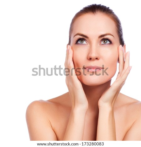 Beautiful Spa Woman Touching her Face. - stock photo