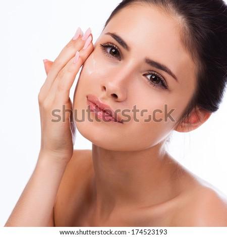 Beautiful Spa Woman Touching her Face. - stock photo