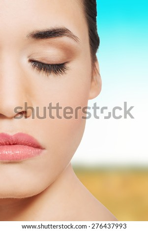 Beautiful spa woman with eyes closed. - stock photo