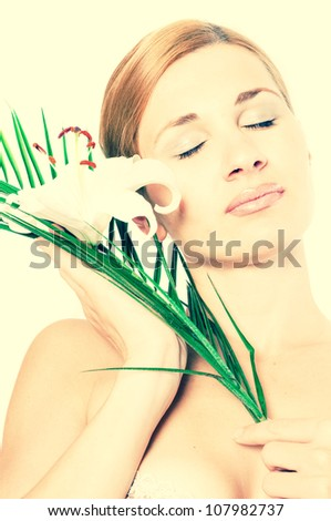 beautiful spa woman with lilly - stock photo