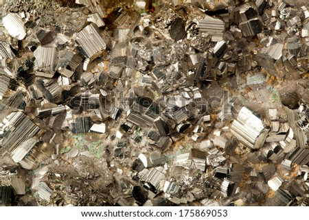 Beautiful specimen of golden pyrite mineral in close up - stock photo