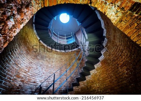 beautiful spiral staircase at a historic building - stock photo