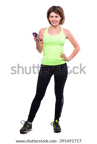 beautiful sport girl with mobile and earphones - stock photo