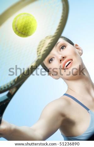 Beautiful sporty girl playing tennis very passionately - stock photo