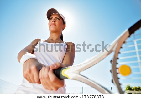 Beautiful sporty girl  with tennis racket playing tennis  - stock photo
