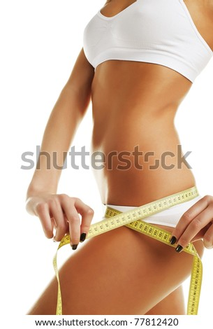 Beautiful sporty woman body with yellow measure on white background - stock photo