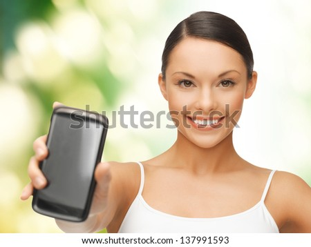 beautiful sporty woman showing smartphone with app - stock photo