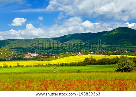 Beautiful spring countryside of the Czech republic, Europe. Photographed from a moving vehicle. - stock photo