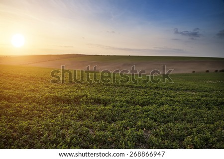 Beautiful Spring evening light over fields landscape on farm - stock photo