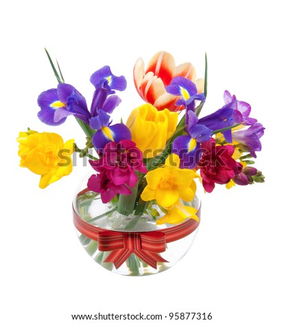 Beautiful spring flowers in a glass - stock photo