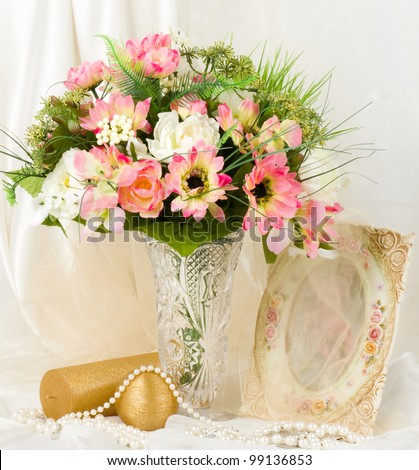 Beautiful spring flowers in a glass vase on background - stock photo