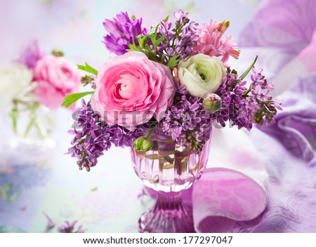Beautiful spring flowers in vase - stock photo