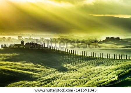 Beautiful spring sunrise over the valley of San Quirico d'Orcia - stock photo