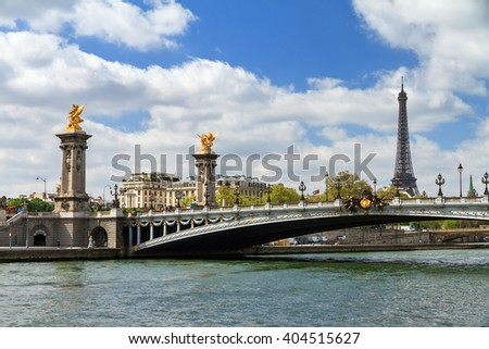 Beautiful spring view of the pont Alexandre III over the river Seine with the Eiffel tower in the background in Paris, France - stock photo