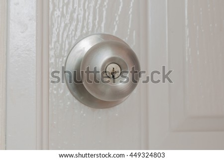 Beautiful stainless steel round ball door knob. - stock photo