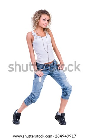 Beautiful standing woman model posing with hands in pockets isolated on a white background - stock photo