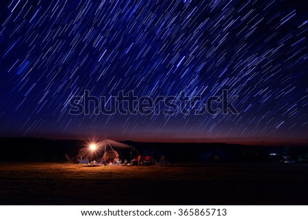 Beautiful star trail image during the night - stock photo