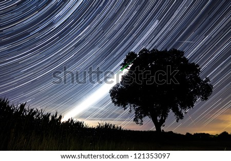 Beautiful star trail image during the night of the Perseid meteor shower in the summer of 2012 in the Netherlands - stock photo