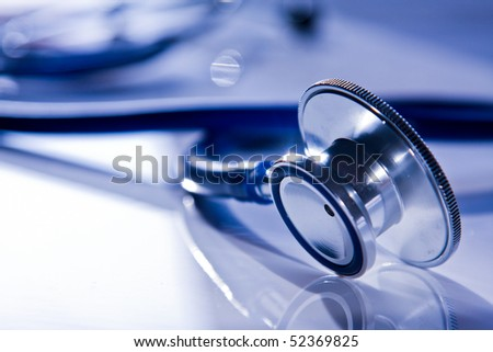 Beautiful stethoscope with reflection and blue tint - stock photo