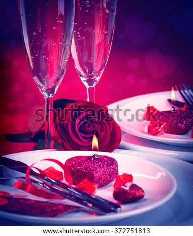 Beautiful still life of romantic dinner in red colors, festive table setting in the restaurant Valentine day, love and romance concept - stock photo