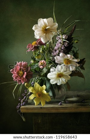 Beautiful still life with a voluptuous bouquet of flowers - stock photo