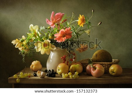 Beautiful still life with flowers and fruit - stock photo