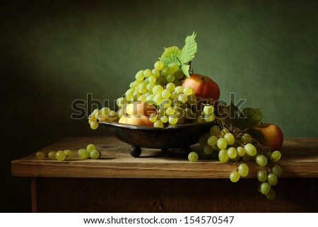 Beautiful still life with grapes and apples - stock photo