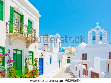 Beautiful stone made road with old traditional houses and a twin church in Chora the capital of Amorgos island in Greece - stock photo