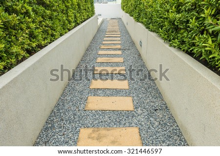 Beautiful stone pathway in the garden - stock photo