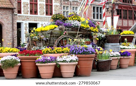 Beautiful street decorated with flowers. Scene europe. - stock photo