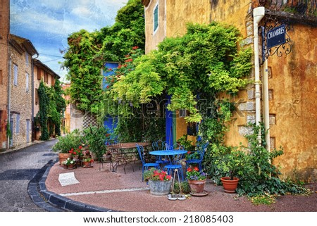 Beautiful street in Villes-sur-Auzon, Provence, France. Filtered image, vintage effect applied  - stock photo