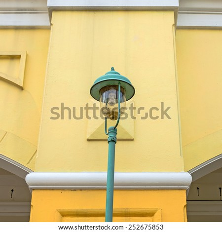 Beautiful street light in front of old building in thailand - stock photo