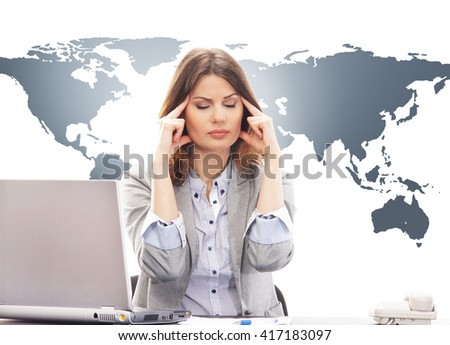 Beautiful stressed and stacked business woman in office on world map background. Global business concept. - stock photo