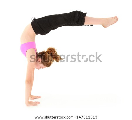 Beautiful strong child in a handstand with legs held out. Clipping path over white. - stock photo